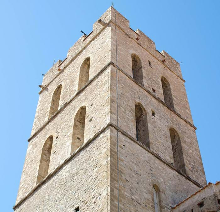 The bell tower of the 14th century Notre Dame del Prat church